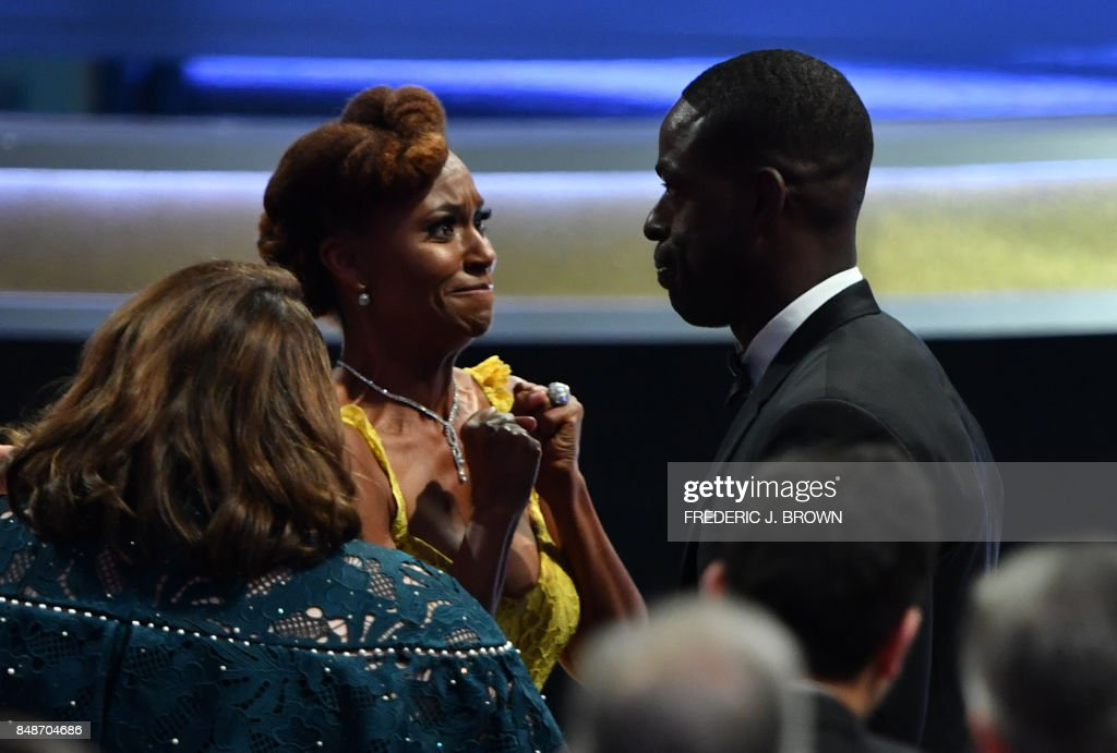Ryan Michelle Bath (L) reacts as her husband Sterling K. Brown (R) wins the award for Outstanding Lead Actor in a Drama Series for 'This is Us' during the 69th Emmy Awards at the Microsoft Theatre on September 17, 2017 in Los Angeles, California. / AFP PHOTO / Frederic J. Brown