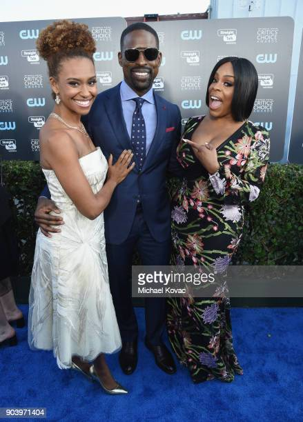 Ryan Michelle Bathe actor Sterling K Brown and actor Niecy Nash attend Moet Chandon celebrate The 23rd Annual Critics' Choice Awards at Barker Hangar...