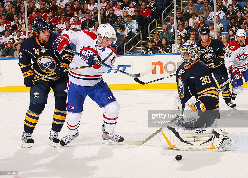 6dd5c2bfc Ryan Miller  30 and Chris Butler  34 of the Buffalo Sabres stop Mike  Cammalleri