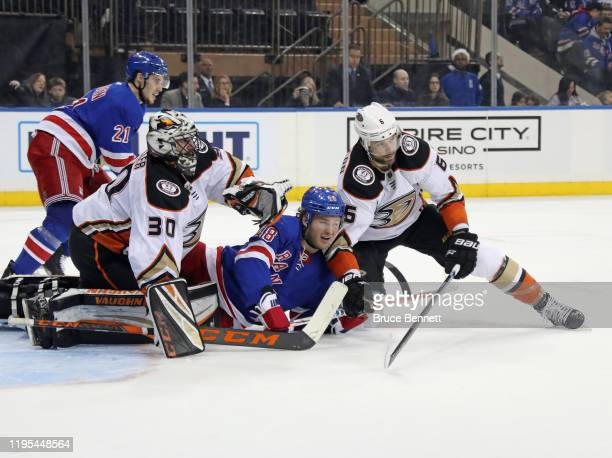 Ryan Miller and Erik Gudbranson of the Anaheim Ducks defend against Brendan Lemieux of the New York Rangers during the second period at Madison...