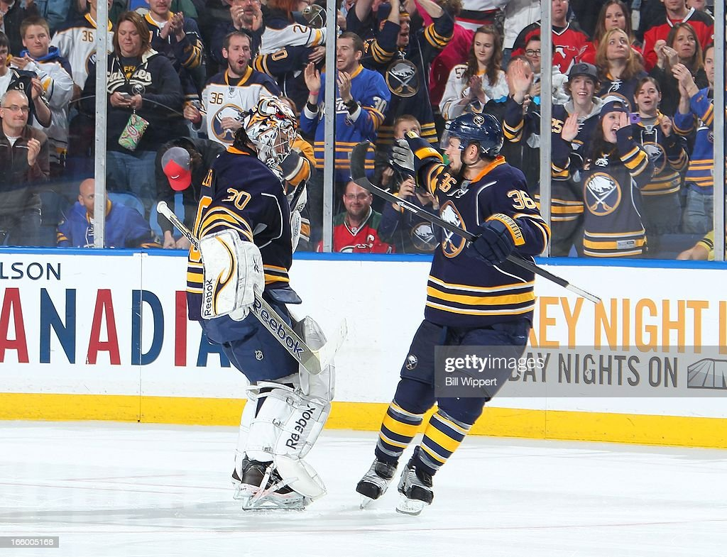 Ryan Miller #30 and Patrick Kaleta #36 of the Buffalo Sabres celebrate their 3-2 shootout victory over the New Jersey Devils on April 7, 2013 at the First Niagara Center in Buffalo, New York.