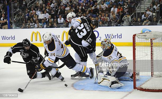 Ryan Miller of Buffalo saves a shot by Brad Richardson of Los Angeles during a friendly match between Buffalo Sabres and Los Angeles Kings at O2...