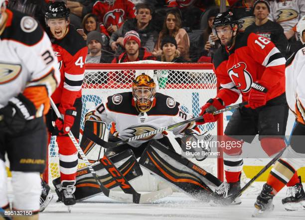 Ryan Miller of the Anaheim Ducks braces for a second period shot while playing against the New Jersey Devils at the Prudential Center on December 18...