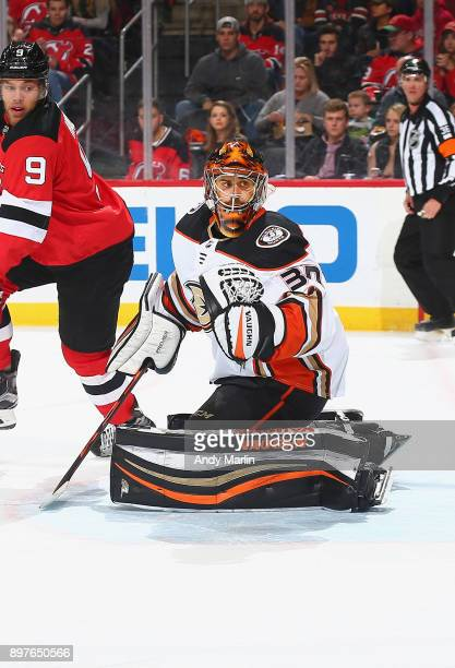 Ryan Miller of the Anaheim Ducks defends his net against the New Jersey Devils at Prudential Center on December 18 2017 in Newark New Jersey
