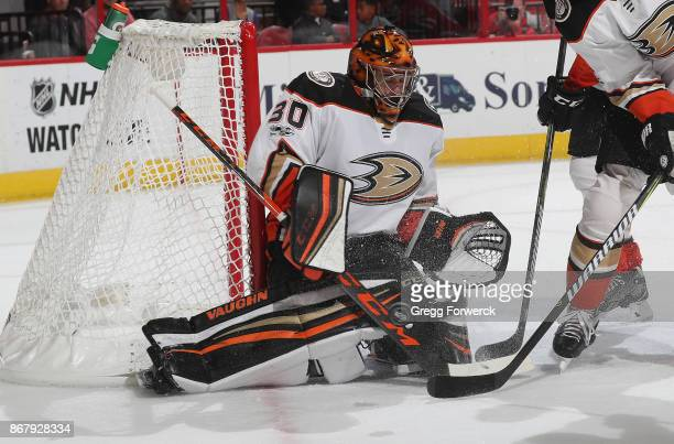 Ryan Miller of the Anaheim Ducks goes down in the crease to deflect the puck away from the net during an NHL game against the Carolina Hurricanes on...