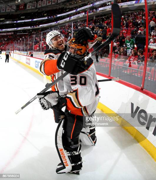Ryan Miller of the Anaheim Ducks is congratulated by teammate Sami Vatanen on his win against the Carolina Hurricanes following an NHL game on...