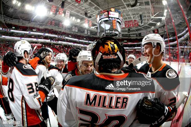 Ryan Miller of the Anaheim Ducks is congratulated by teammates on his win against the Carolina Hurricanes following an NHL game on October 29 2017 at...