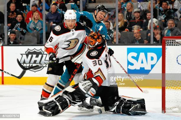Ryan Miller of the Anaheim Ducks makes a save as Brandon Montour of the Anaheim Ducks defends Tomas Hertl of the San Jose Sharks at SAP Center on...