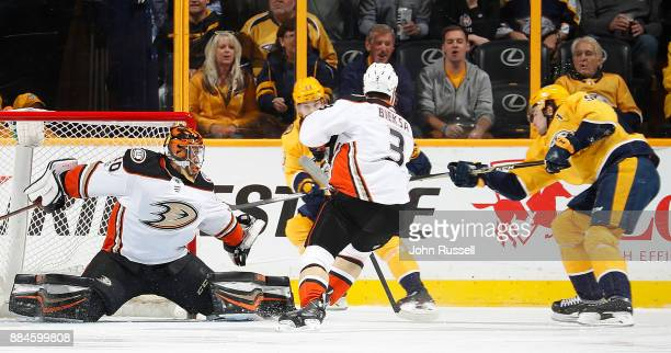 Ryan Miller of the Anaheim Ducks makes the save against Filip Forsberg of the Nashville Predators during an NHL game at Bridgestone Arena on December...