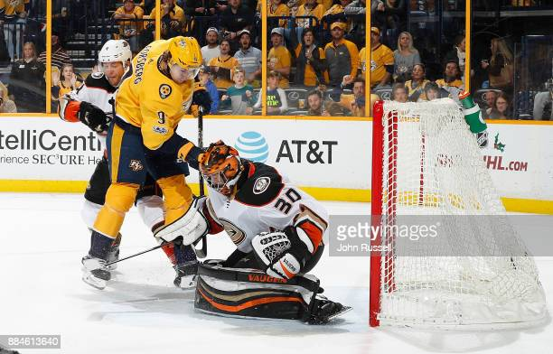 Ryan Miller of the Anaheim Ducks makes the save against Filip Forsberg of the Nashville Predators in overtime of an NHL game at Bridgestone Arena on...
