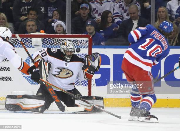 Ryan Miller of the Anaheim Ducks makes the third period save on Artemi Panarin of the New York Rangers at Madison Square Garden on December 22 2019...