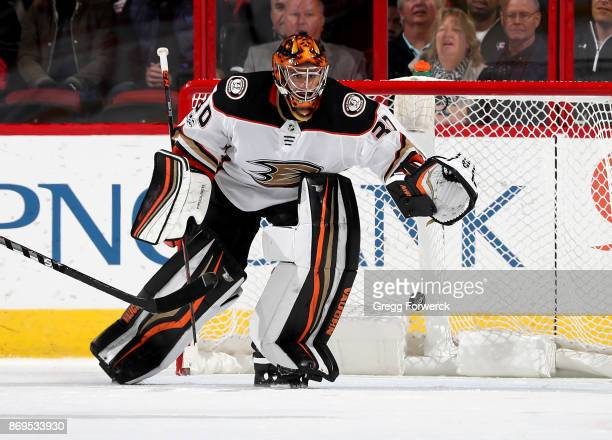 Ryan Miller of the Anaheim Ducks plays a puck near the crease during an NHL game against the Carolina Hurricanes on October 29 2017 at PNC Arena in...