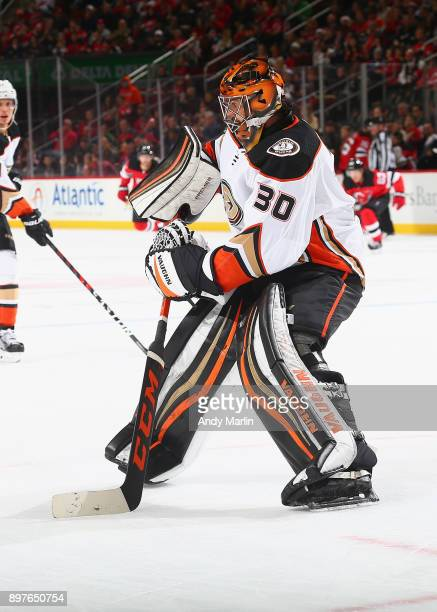 Ryan Miller of the Anaheim Ducks plays the puck against the New Jersey Devils at Prudential Center on December 18 2017 in Newark New Jersey