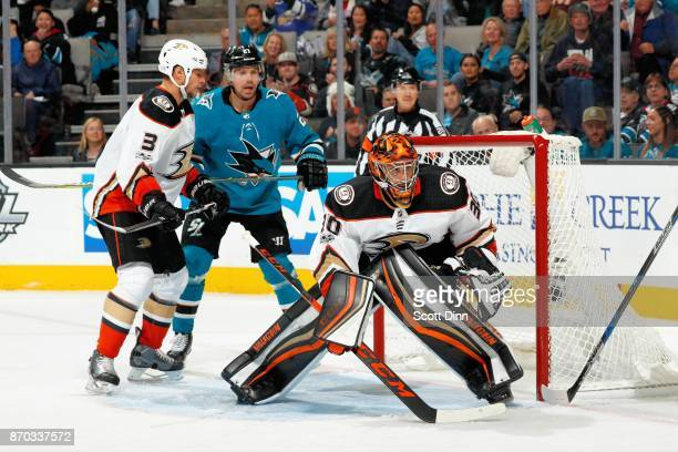 Ryan Miller of the Anaheim Ducks protects the net as Kevin Bieksa of the Anaheim Ducks defends Joonas Donskoi of the San Jose Sharks at SAP Center on...