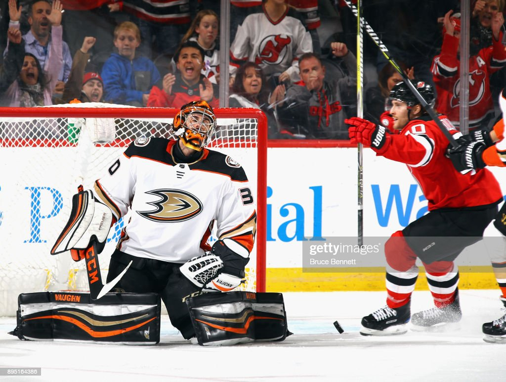 Ryan Miller #30 of the Anaheim Ducks reacts after giving up a third period goal to Jesper Bratt #63 (not shown) at the Prudential Center on December 18, 2017 in Newark, New Jersey. The Devils defeated the Ducks 5-3.