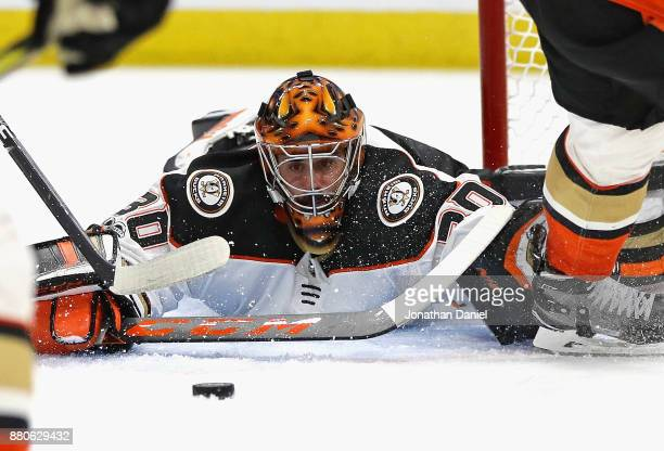 Ryan Miller of the Anaheim Ducks sprals to make a save against the Chicago Blackhawks at the United Center on November 27 2017 in Chicago Illinois