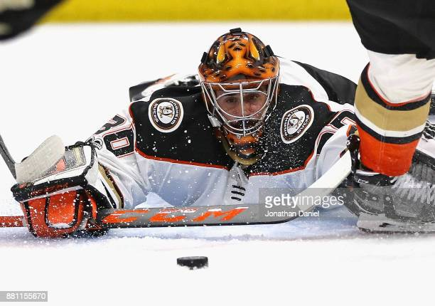 Ryan Miller of the Anaheim Ducks sprals to make a save against the Chicago Blackhawks at the United Center on November 27 2017 in Chicago Illinois...