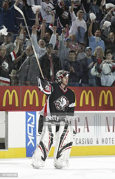 Ryan Miller of the Buffalo Sabres acknowledges the crowd after being named the first star after a shutout victory against the Philadelphia Flyers in...