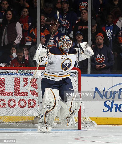 Ryan Miller of the Buffalo Sabres celebrates the Sabres 43 shoot out victory over the New York Islanders at the Nassau Veterans Memorial Coliseum on...