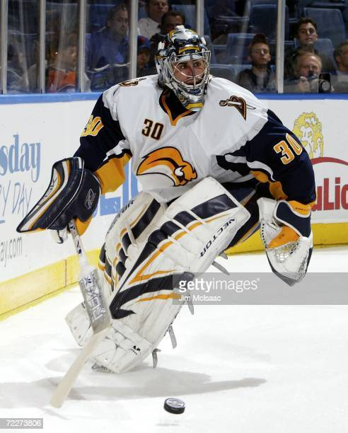 Ryan Miller of the Buffalo Sabres controls the puck against the New York Islanders during their game on October 26 2006 at Nassau Coliseum in...