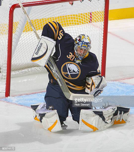 Ryan Miller of the Buffalo Sabres deflects the puck over the net against the Toronto Maple Leafs at HSBC Arena on October 30 2009 in Buffalo New York