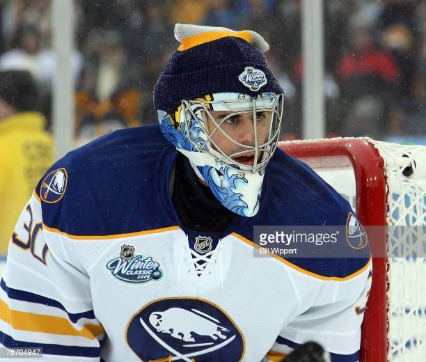 Ryan Miller of the Buffalo Sabres eyes the puck in their game against the Pittsburgh Penguins in the NHL Winter Classic on January 1, 2008 at Ralph...