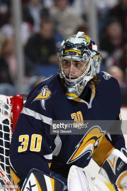 Ryan Miller of the Buffalo Sabres hugs the post as he follows the play along the boards during a preseason game against the Pittsburgh Penguins at...