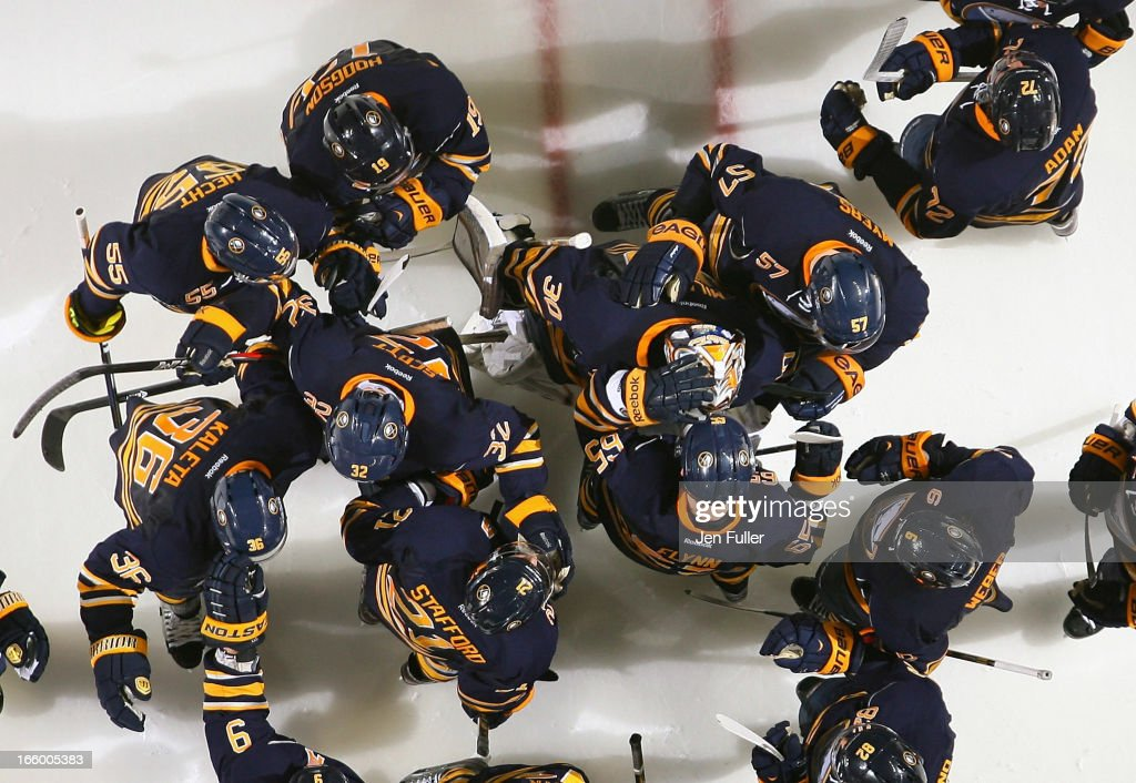 Ryan Miller #30 of the Buffalo Sabres is congratulated by teammates after their 3-2 shootout victory against the New Jersey Devils on April 7, 2013 at the First Niagara Center in Buffalo, New York.