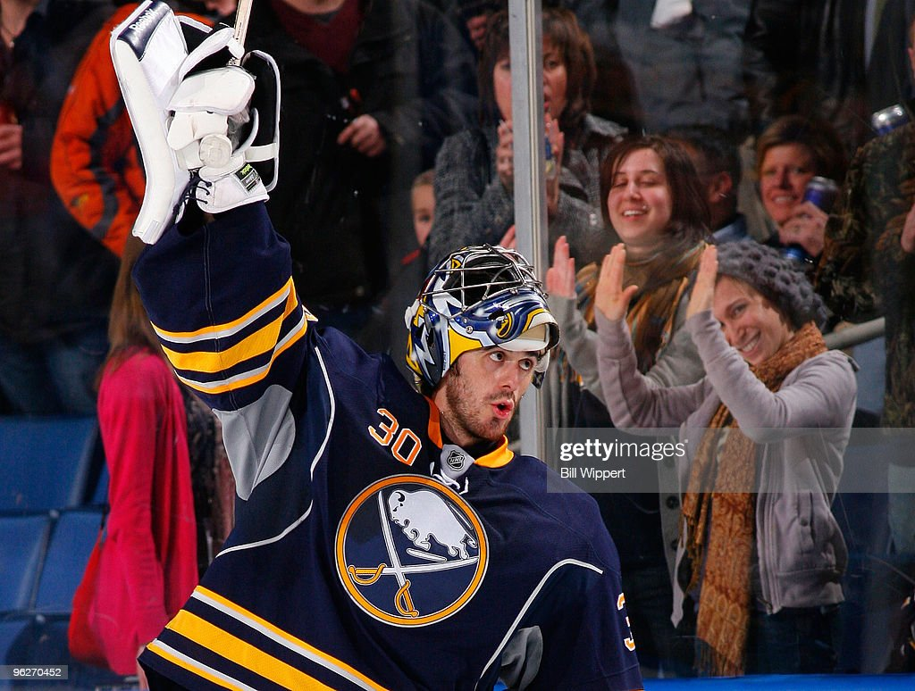Ryan Miller #30 of the Buffalo Sabres joins fans in celebrating their 2-1 victory over the Boston Bruins on January 29, 2010 at HSBC Arena in Buffalo, New York.
