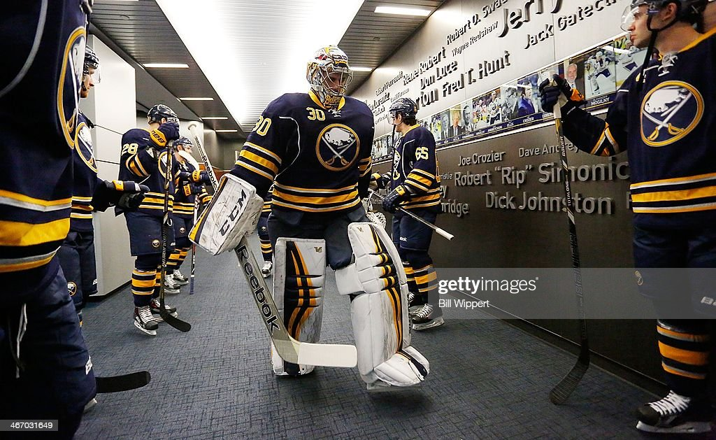 Ryan Miller #30 of the Buffalo Sabres leads his team to the ice to play the Pittsburgh Penguins on February 5, 2014 at the First Niagara Center in Buffalo, New York.