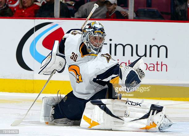 Ryan Miller of the Buffalo Sabres makes a glove save against the New Jersey Devils during their game on February 3 2007 at Continental Airlines Arena...