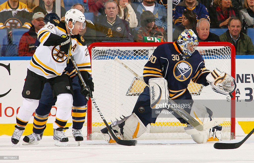 Ryan Miller #30 of the Buffalo Sabres makes a glove save in front of Mark Recchi #28 of the Boston Bruins on January 29, 2010 at HSBC Arena in Buffalo, New York.