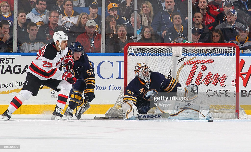 Ryan Miller #30 of the Buffalo Sabres makes a save alongside teammate Mark Pysyk #53 and Tom Kostopoulos #25 of the New Jersey Devils on April 7, 2013 at the First Niagara Center in Buffalo, New York. Buffalo defeated New Jersey, 3-2.
