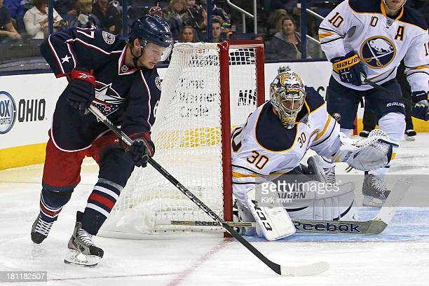 Ryan Miller of the Buffalo Sabres makes a save on a wrap around attempt by Nick Moutrey of the Columbus Blue Jackets on September 2013 at Nationwide...