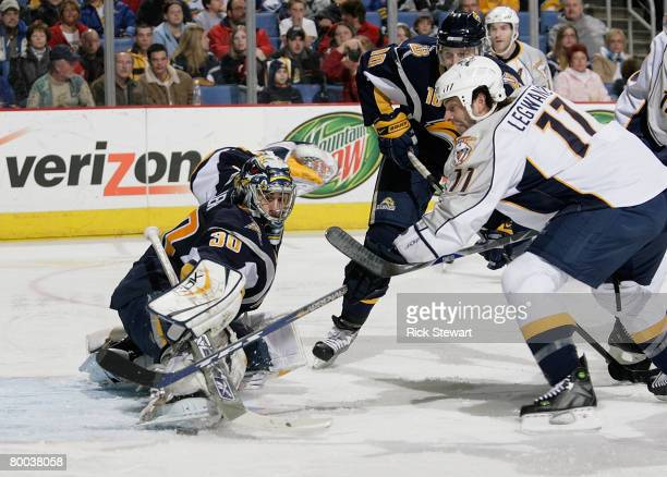 Ryan Miller of the Buffalo Sabres makes a save on David Legwand of the Nashville Predators on February 27, 2008 at HSBC Arena in Buffalo, New York....