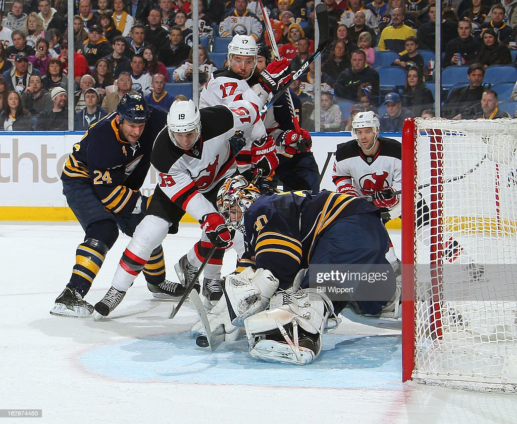 Ryan Miller #30 of the Buffalo Sabres makes a second period save against Travis Zajac #19 of the New Jersey Devils on March 2, 2013 at the First Niagara Center in Buffalo, New York.