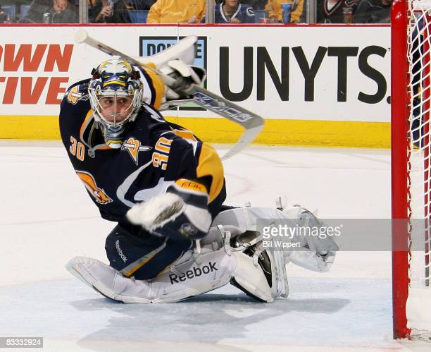 Ryan Miller of the Buffalo Sabres makes a second period save against the Vancouver Canucks on October 17, 2008 at HSBC Arena in Buffalo, New York.