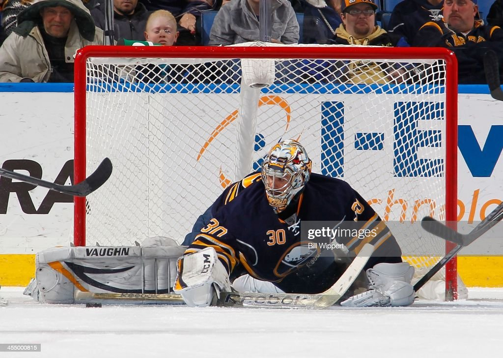 Ryan Miller #30 of the Buffalo Sabres makes a third period pad save in their 2-1 shootout victory over the Ottawa Senators on December 10, 2013 at the First Niagara Center in Buffalo, New York.