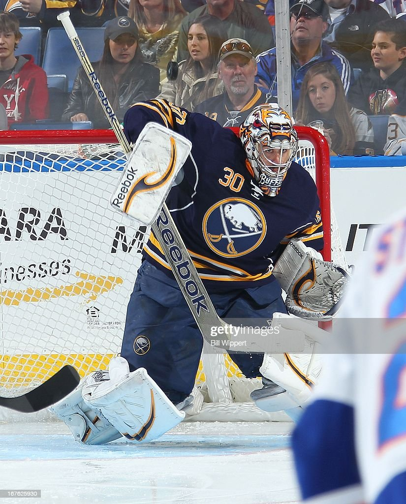 Ryan Miller #30 of the Buffalo Sabres makes a third-period save in a 2-1 victory over the New York Islanders on April 26, 2013 at the First Niagara Center in Buffalo, New York. Miller played in his 500th career NHL game.