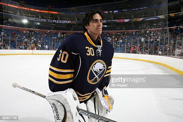 Ryan Miller of the Buffalo Sabres skates off the ice as they unveil their new third jersey during a training camp practice on September 20, 2008 at...