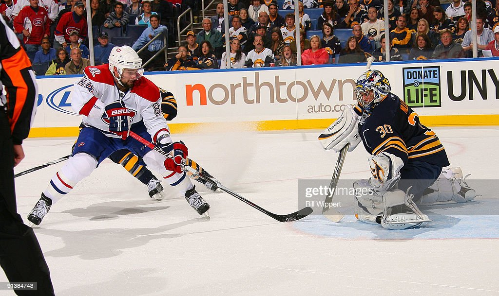 a907d70e1 Ryan Miller  30 of the Buffalo Sabres stops Guillaume Latendresse  84 of  the Montreal