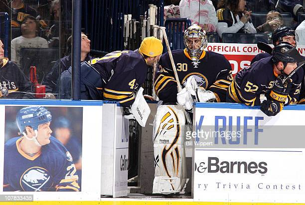 Ryan Miller of the Buffalo Sabres talks to fellow goaltender Patrick Lalime in a game against the Florida Panthers at HSBC Arena on December 23, 2010...