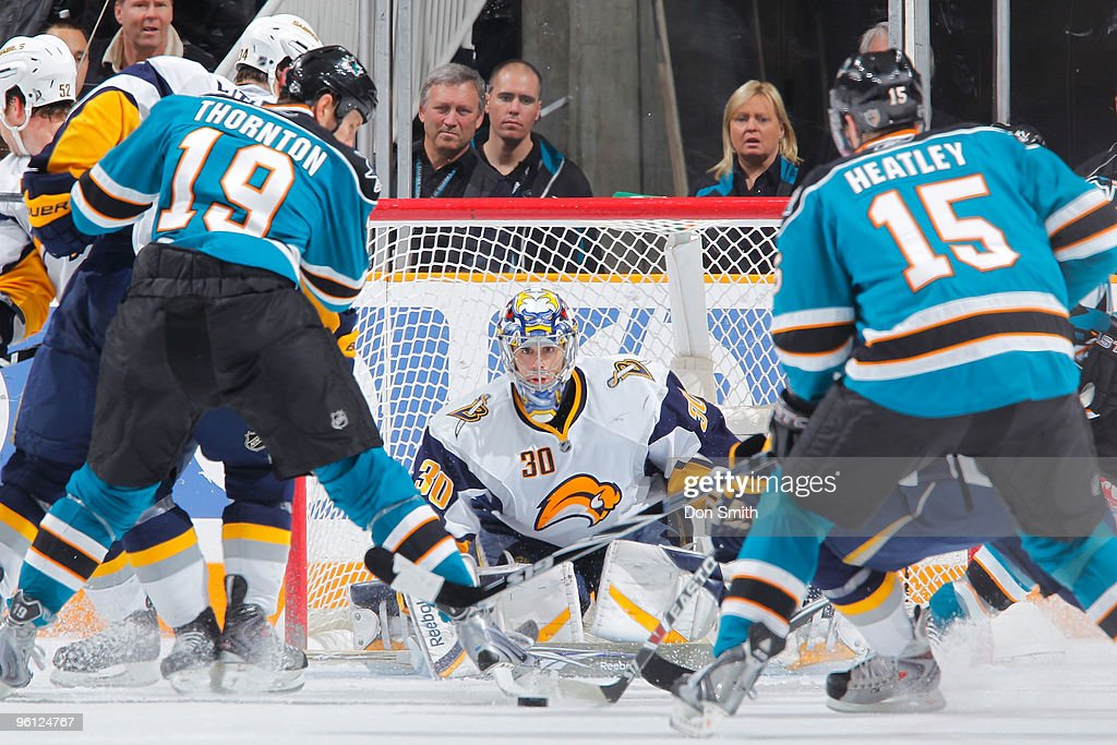Ryan Miller #30 of the Buffalo Sabres watches the puck come barrelling toward him along with Joe Thornton #19 and Dany Heatley #15 of the San Jose Sharks during an NHL game on January 23, 2010 at HP Pavilion at San Jose in San Jose, California.