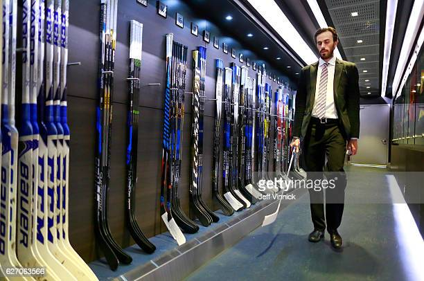 Ryan Miller of the Vancouver Canucks carries his game stick as he walks to the team dressing room before their NHL game against the Anaheim Ducks at...