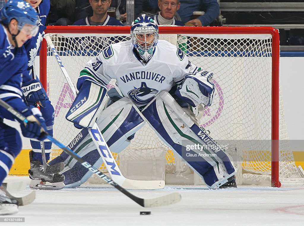 Ryan Miller #30 of the Vancouver Canucks gets set to face a shot against the Toronto Maple Leafs during an NHL game at the Air Canada Centre on November 5, 2016 in Toronto, Ontario, Canada. The Leafs defeated the Canucks 6-3.