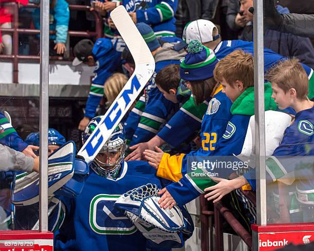Ryan Miller of the Vancouver Canucks is greeted by fans on the way to the ice prior to their NHL game against the Anaheim Ducks at Rogers Arena...
