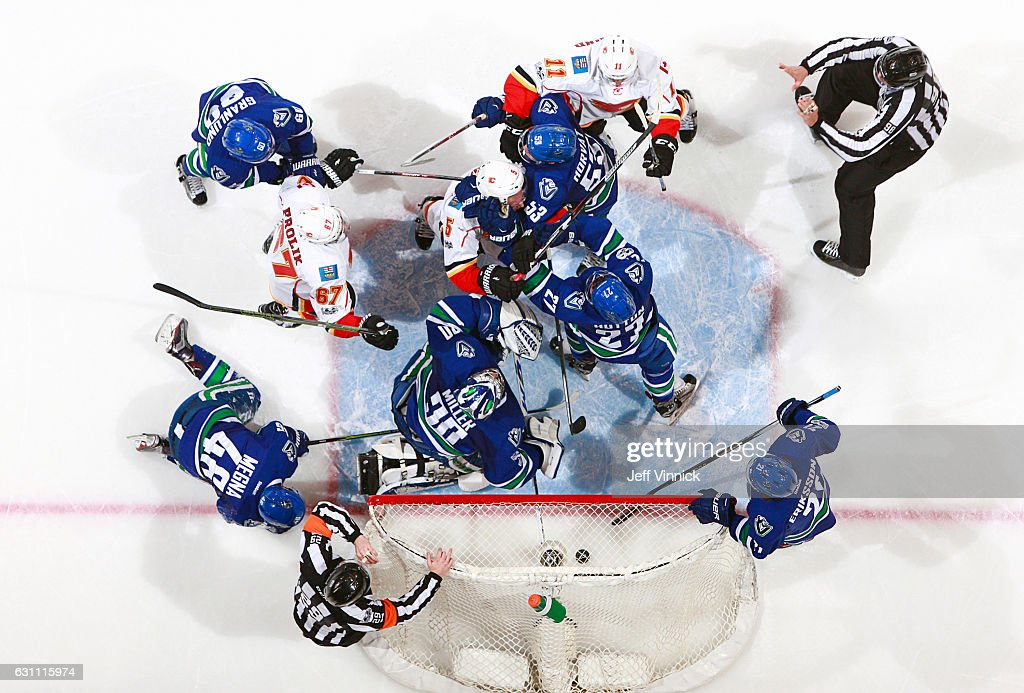 Ryan Miller #30 of the Vancouver Canucks is surrounded by players during their NHL game at Rogers Arena January 6, 2017 in Vancouver, British Columbia, Canada. Vancouver won 4-2.