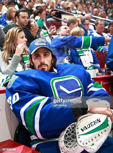Ryan Miller of the Vancouver Canucks looks on from the bench during their NHL game against theTampa Bay Lightning at Rogers Arena October 18, 2014 in...