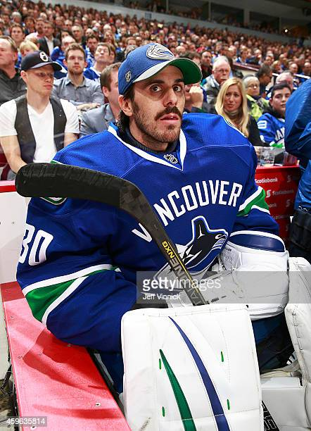 Ryan Miller of the Vancouver Canucks looks on from the bench during their NHL game against the Anaheim Ducks at Rogers Arena November 20 2014 in...
