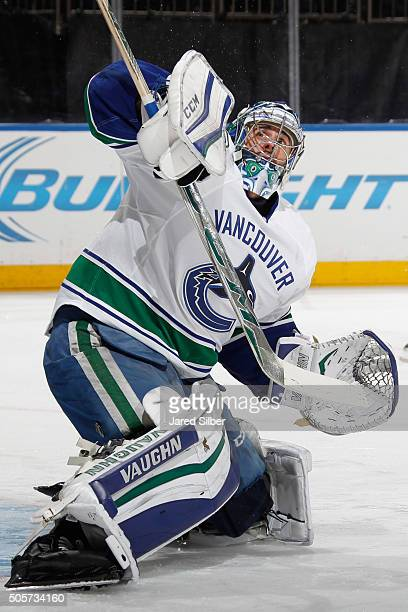 Ryan Miller of the Vancouver Canucks makes a blocker save during pregame warmups before the game against the New York Rangers at Madison Square...